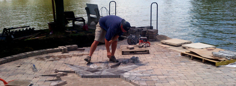 Blake installing custom patio on the lake