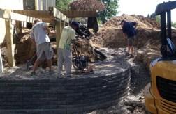 Landscape crew building retaining wall